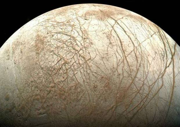 Jupiter's ice-covered moon Europa hides a water ocean beneath its surface. A return mission is now planned to help search for evidence of life there. Photo Credit: NASA/JPL