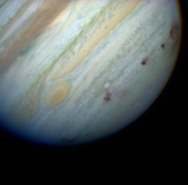 Dark scars in Jupiter's upper atmosphere created by the Shoemaker-Levy 9 impact in 1994, as photographed by the Hubble Space Telescope. Credit: Hubble Space Telescope / NASA