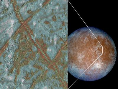 "The brownish ""smudges"" on Europa's surface are thought to be places where water from the ocean below has reached the surface, depositing minerals or other material. Image Credit: NASA/JPL-Caltech"