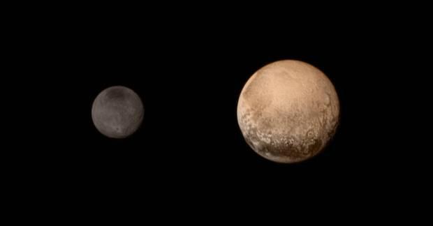 Pluto and Charon in colour, July 11, 2015. Image Credit: NASA/JHUAPL/SWRI