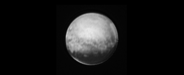 "The newest image of Pluto, taken on July 8, 2015 by New Horizons. Some interesting features with bright edges can be seen. Most of the bright features around Pluto's edge are a result of image processing, but the bright sliver below the dark ""whale,"" which is also visible in unprocessed images, is real. Image Credit: NASA-JHUAPL-SWRI"