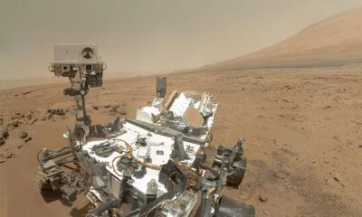 Possible RSL have also been seen on the slopes of Mount Sharp in Gale crater (in background of this image), the location of the Curiosity rover, but that has not been confirmed yet. It is also not yet known if the rover would be able to reach them. Image Credit: NASA/JPL-Caltech
