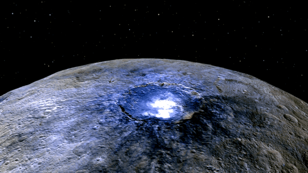 False color view of Occator crater on Ceres, showing the unusual bright spots. The image was taken by the framing camera on NASA's Dawn spacecraft from a distance of about 2,700 miles (4,400 kilometers). Image Credit: NASA/JPL-Caltech/UCLA/MPS/DLR/IDA