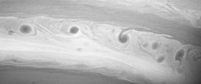 """Closer view of one of Saturn's """"storm alleys"""" where the storms stretch out until they encircle the planet. Photo Credit: NASA/JPL/Space Science Institute"""