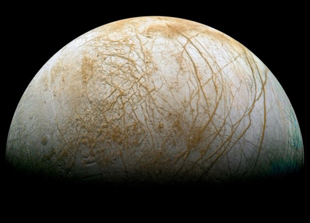 The ocean moon Europa, with its heavily cracked icy surface. Credit: NASA/JPL/Stryk