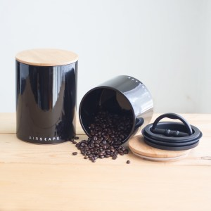 Photo of a large and small black airscape coffee canister set.