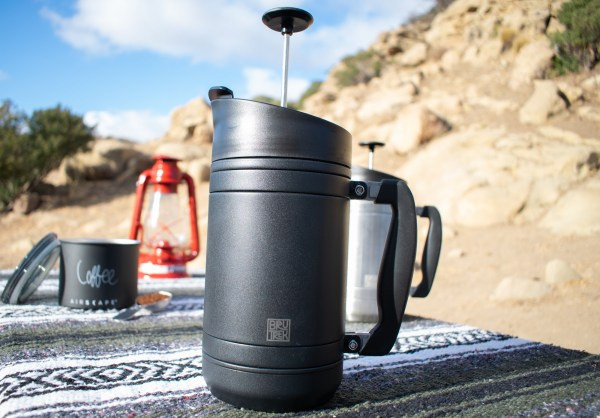 Photo of obsidian BruTrek on native blanket with lantern and Airscape coffee canister