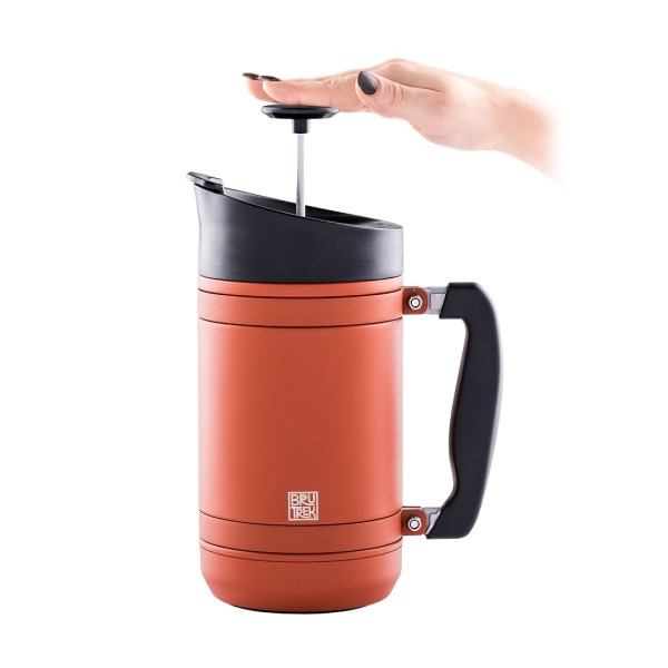 Photo of 32oz, Red Rock color BruTrek insulated French press with hand on plunger