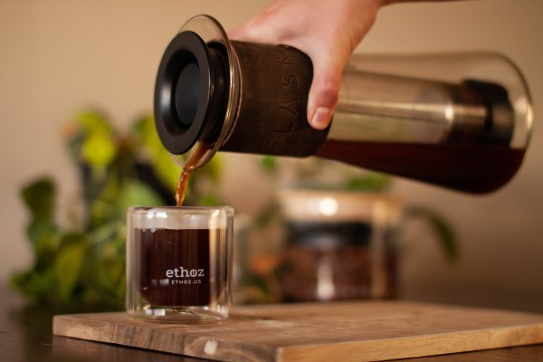 photo of FLASK french press pouring coffee into glass tumbler