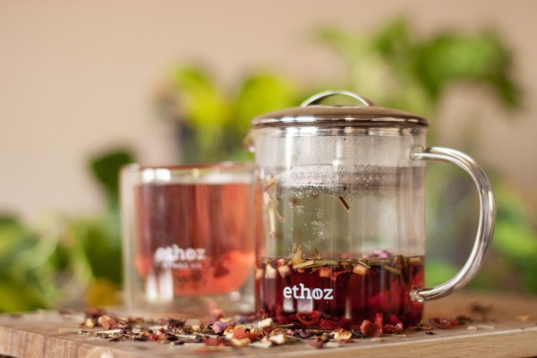 photo of ethoz tea brewer and tumbler filled with tea