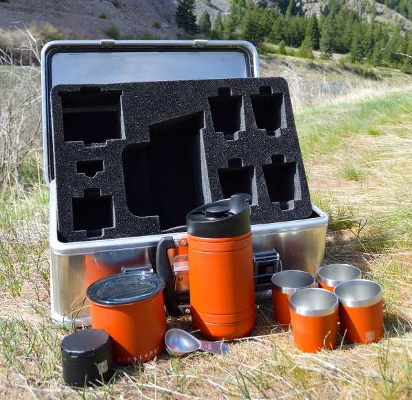 photo of coffee expedition kit with red products in front of case with removable foam