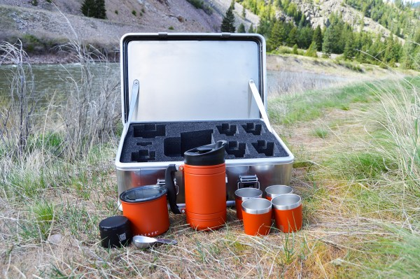 photo of coffee expedition kit with red products in front of case