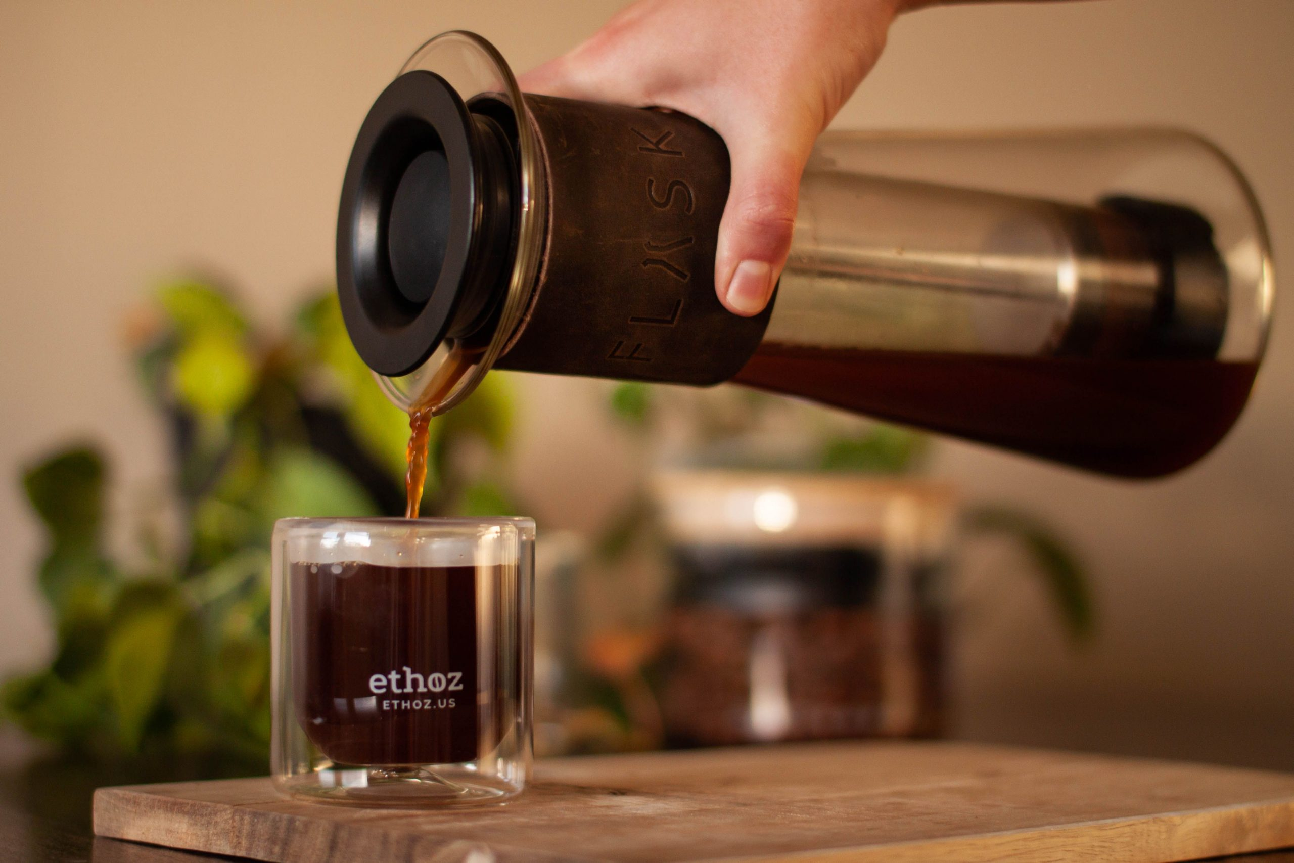 picture of Flask french press pouring brewed coffee into glass cups