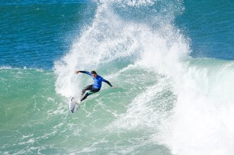 Rookie Leonardo Fioravanti of Italy advances to Round Three of the Corona Open J-Bay after defeating Sebastien Zietz of Hawaii in Heat 7 of Round Two in pumping Supertubes, Jeffreys Bay, South Africa.