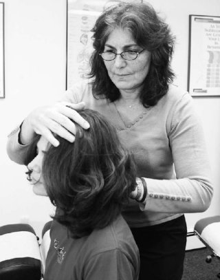 Anita Morgenstern treats a patient at her office in Hastings.