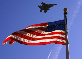 American Flag with jet flying over
