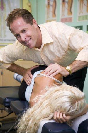 chiropractor demonstrating side posture sacral adjustment
