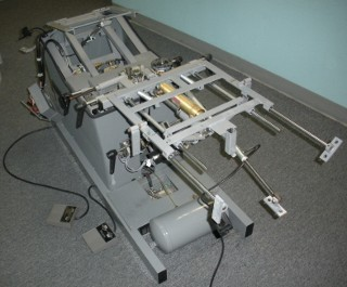 disassembled flexion distraction unit