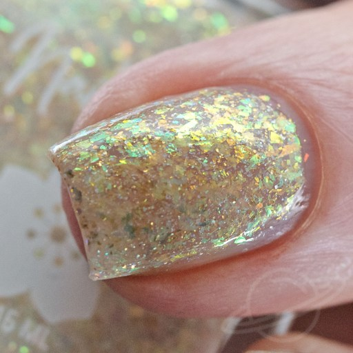 4 finger swatch of Nailed It Nail Polish X's & O's one of four polishes in the Candygram Collection Macro