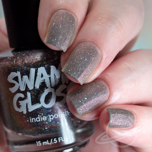 Four finger nail swatch of Dangersome - a purple/black/red multichrome packed with holographic pigment and holo flakes nail polish by Swamp Gloss polish - MATTE