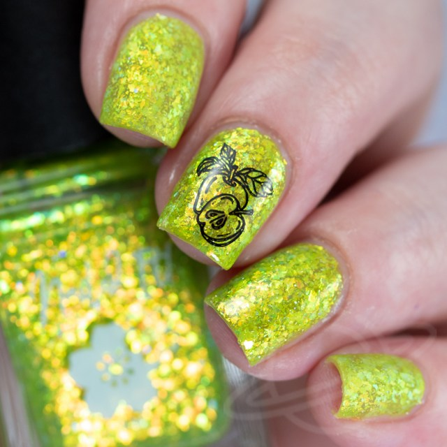 This image features a four finger swatch with the nail polish Green Apple-y Ever After: A lime green jelly base packed with gold/copper/green crystal flakes, and a touch of holo flakies from Nailed It! Nail Polish new collection Taste the Rainbow