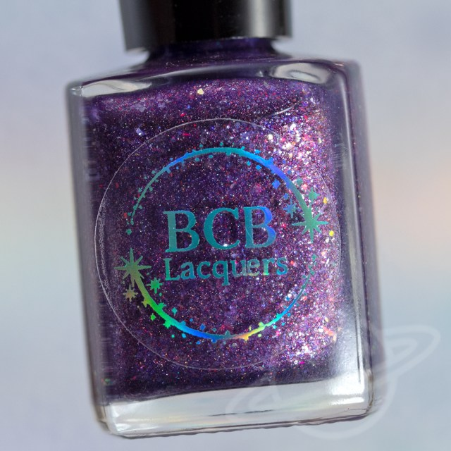 picture of nail polish bottle named Non Timebo Mala by BCB Lacquers - polish is purple with flakies. Part of The Very Supernatural Collab