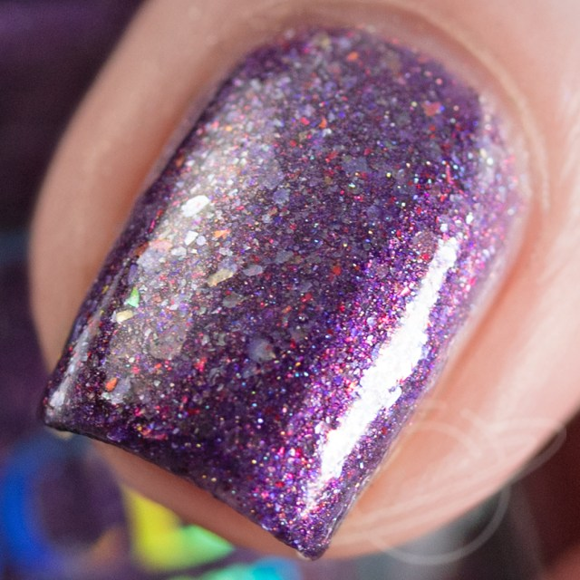 Swatch of nail polish named Non Timebo Mala by BCB Lacquers on one nail polish is purple with flakies. Part of The Very Supernatural Collab