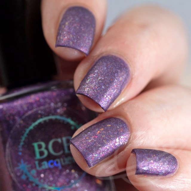 Matte swatch of nail polish named Non Timebo Mala by BCB Lacquers on four finger nails - polish is purple with flakies. Part of The Very Supernatural Collab