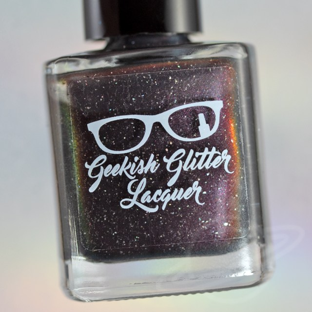 Pictured here is a nail polish bottle which is part of The Very Supernatural Collab. The polish pictured here is named Let's Finish This Game created by Geekish Glitter Lacquer