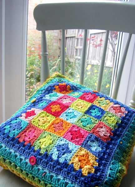 Planet Penny Cotton Cushion on school chair