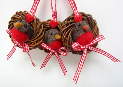 Three robins in twig rings
