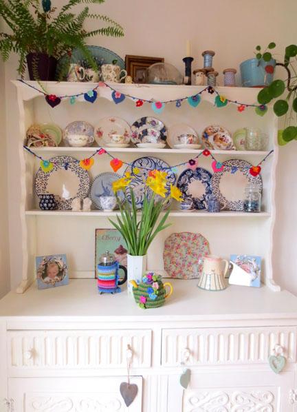 dresser with crochet heart and flower garland