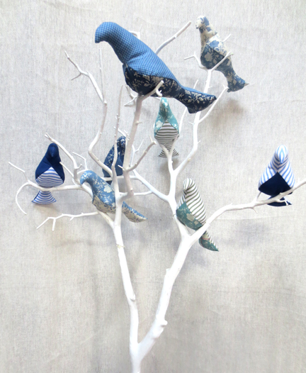 blue fabric birds in tree