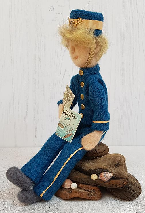 Herbert Lemon from Malamander sitting on driftwood