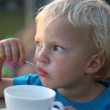 John John drinking his 10th daily cup of sugary tea