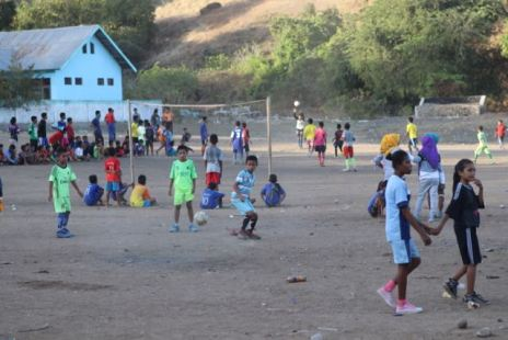 Kids playing football in village yard