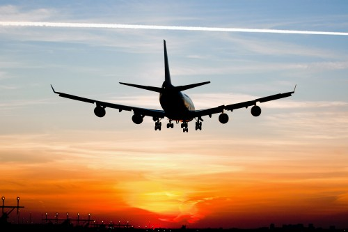 Plane landing by sunrise