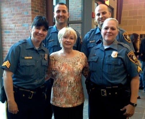 Pictured (l-r): Officers JoAnne Malta, Stephen Lattin, Michael Schubert and Marla Montague with Barbara Ritz, center.