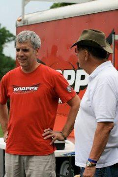 LeRoy Harms (r) chats with bike mechanic Pete Garnich.