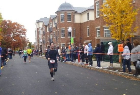 Brad Ackerman of Princeton reaches the finish line. His son, Alex, 13, also ran the race.