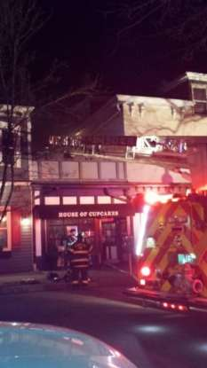 Firefighters fight a blaze at the House of Cupcakes. Photo: Jeffrey Jimenez.