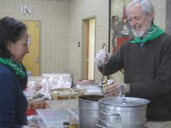 Photo: Noemi de la Puente (l) enjoys soup served up by Mark Toto (r) at the 2013 Living Local Expo.
