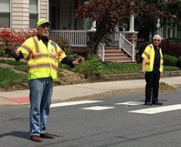 Fire volunteers Roz Warren and Ray Wadsworth direct traffic at Communiversity 2013.