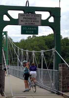 Barb Keener of New Hope, Pa. crosses the Delaware as she completes her 25th consecutive Anchor House Ride for Runaways.
