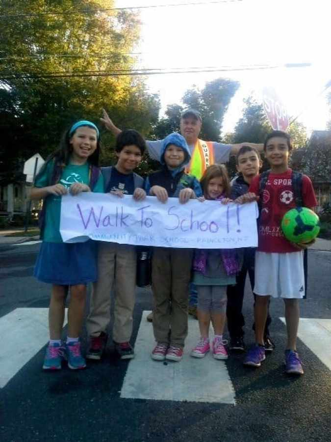 Students from Community Park School and crossing guard Joe Scullion show their Walk to School Day spirit bright and early this morning.