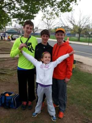 Charlie Roth with his three children after they all ran the Princeton 5K in May.