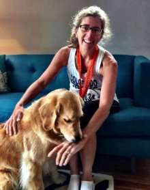 Meg Caddeau relaxes with her dog after the 2013 Princeton Half Marathon.