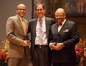 Princeton University President Christopher Eisgruber congratulates Martin Luther King Journey Award winners David Campbell (l) and Kenneth Grayson (r).