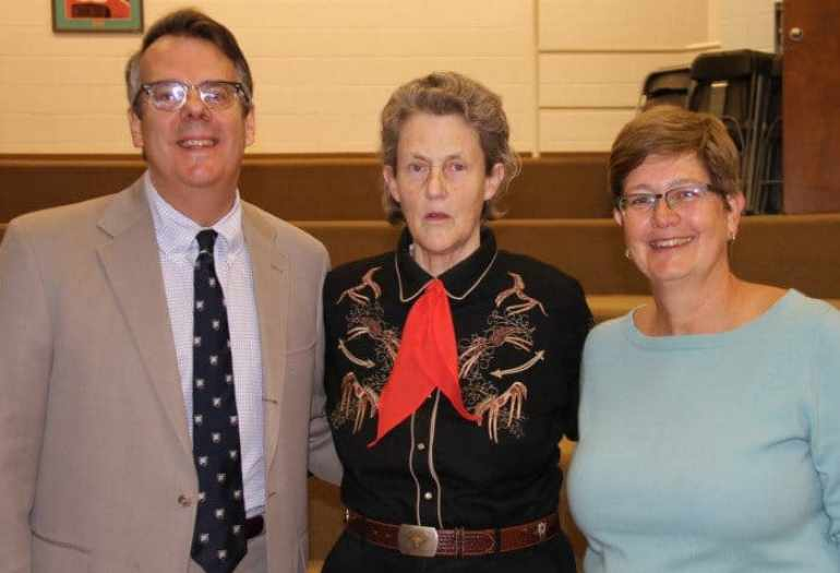 Temple Grandin (c) with Princeotn Day School Head of School Paul Stellato (l) and science department Chair Silvia Strauss-Debenedetti (r).
