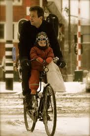 gent and child on bike